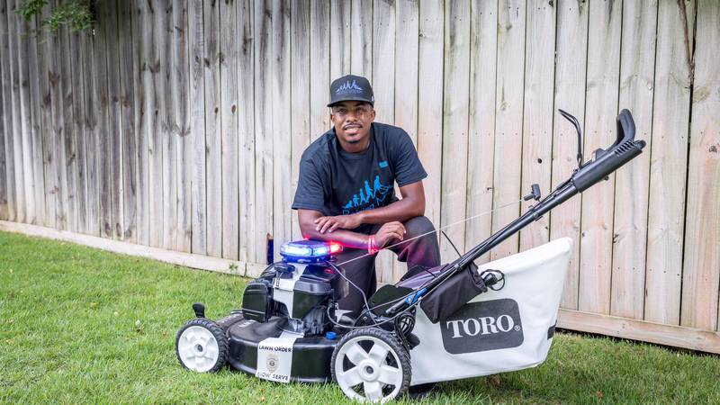 """Rodney Smith Jr. is mowing lawns across the country for his """"Mowing with Cops"""" tour."""
