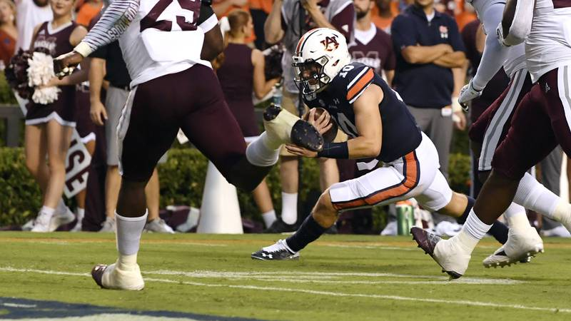 Bo Nix (10) scores a touchdown in the first half.Auburn Football vs Miss State on Saturday,...