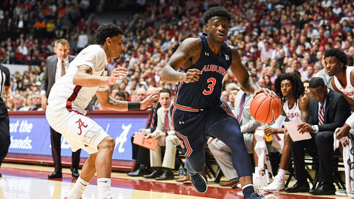 Auburn Tigers forward Danjel Purifoy (3) drives to the basket during the first half between the...