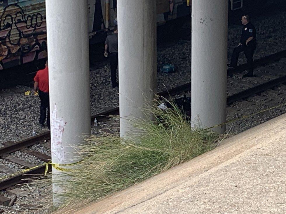 Investigators at the scene where the La Vega High School student was struck and killed by a...