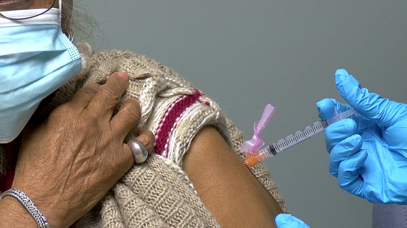 A woman receives a COVID-19 vaccine at Cahaba Medical Care.