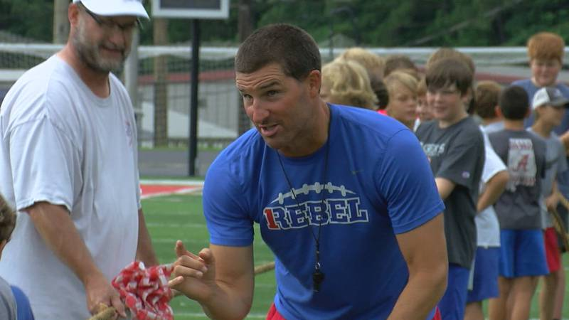 Sean Calhoun coaches at the Rebels youth football camp.