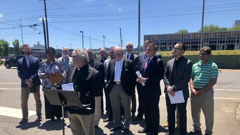 Birmingham-area pastors speak in front of a new Planned Parenthood location under construction...