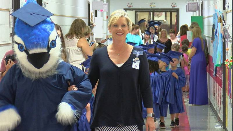 Oak Mountain students walk the hallways in cap and gown
