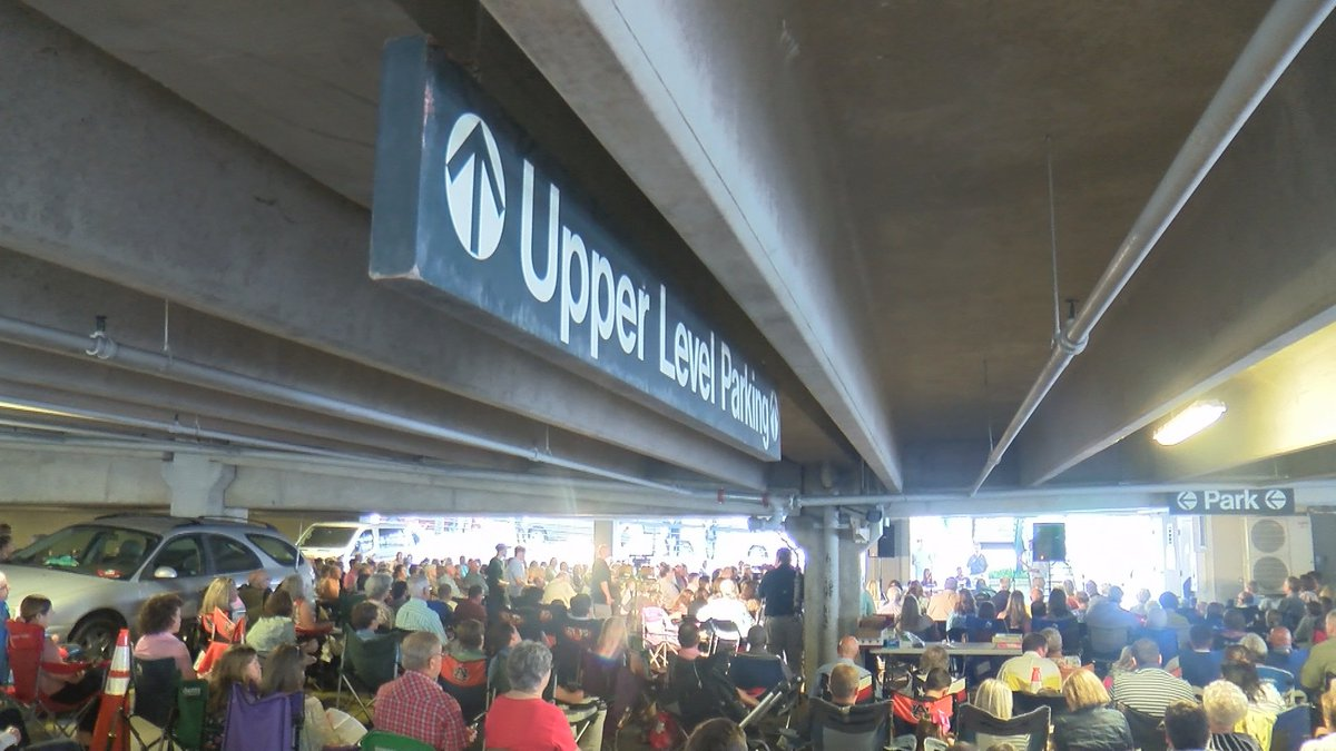 Hundreds of churchgoers gathered for worship on the first level of a Scott Street parking deck...
