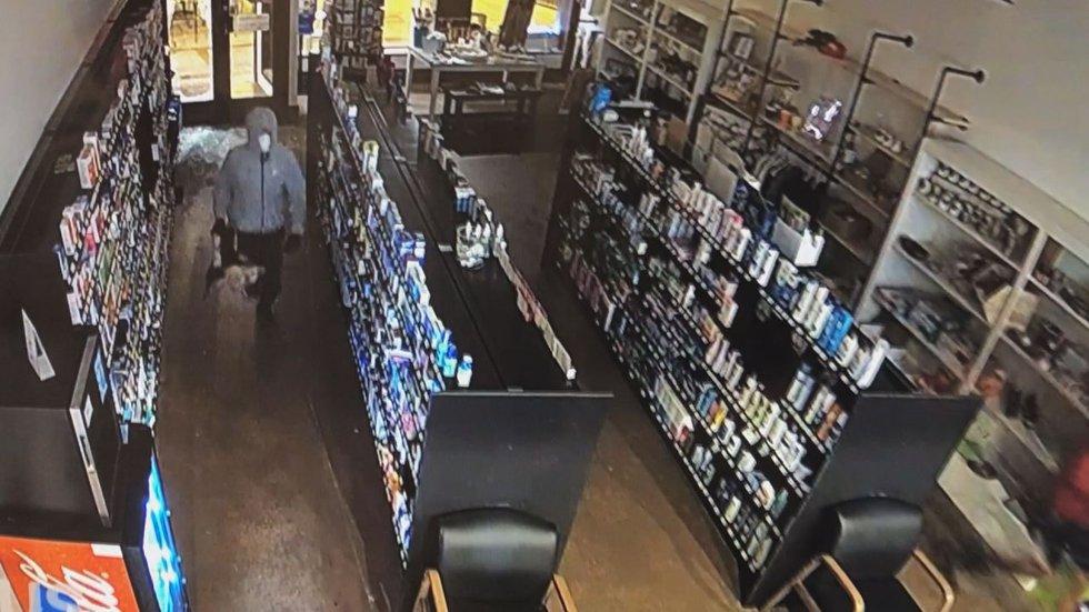 Surveillance cameras captured two men break into Homewood Pharmacy.