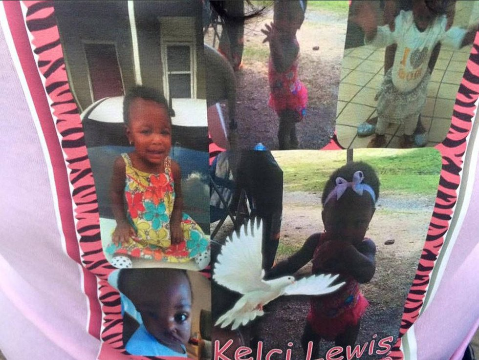 Photos of Kelcia Lewis were printed on a T-shirt worn by friends and family who held a vigil...