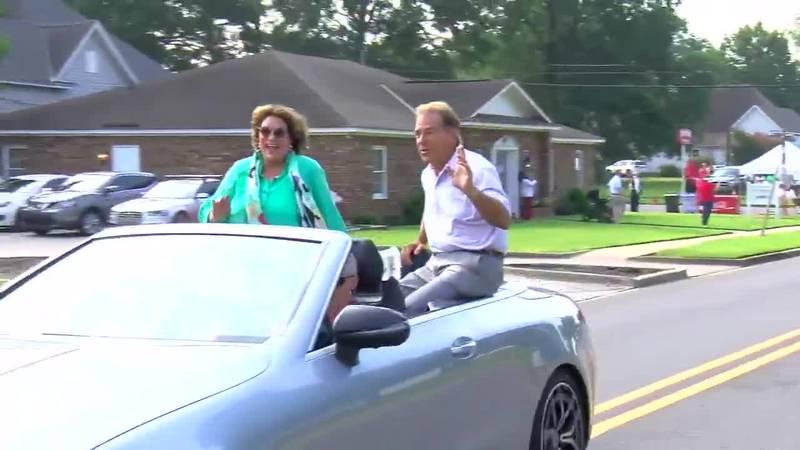 Terry and Nick Saban riding on Nick's Kids Avenue
