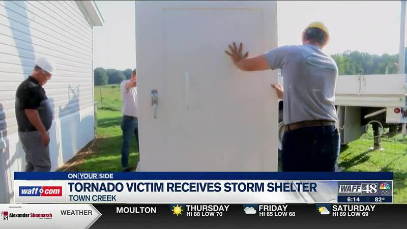 Tornado victim receives storm shelter
