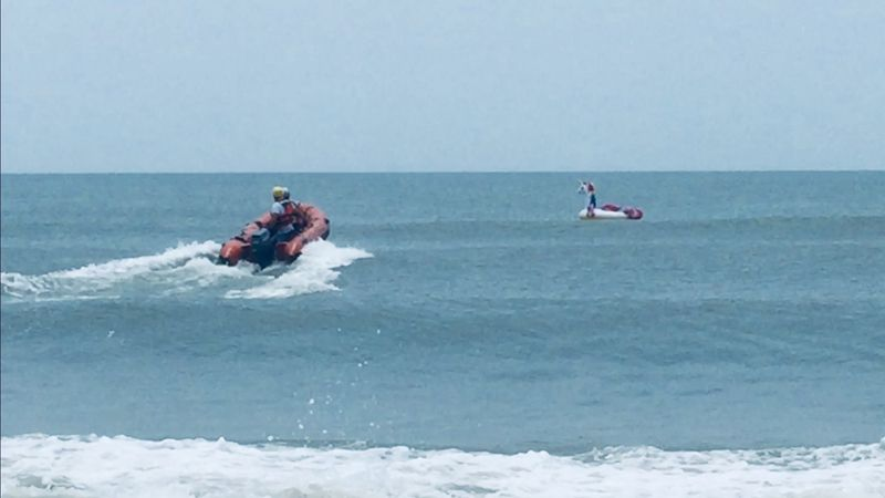 Crews rescued a boy stuck on a unicorn raft an estimated half mile from shore in Oak Island, NC...