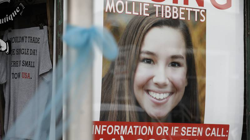 In this Aug. 21, 2018, file photo, a poster for missing University of Iowa student Mollie...