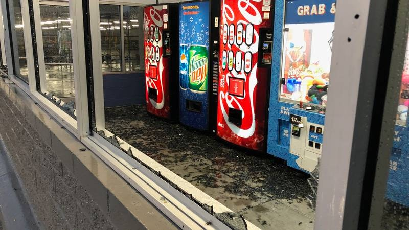Strong winds blew out windows in the Ocean Springs' Walmart's main entrance early Thursday...