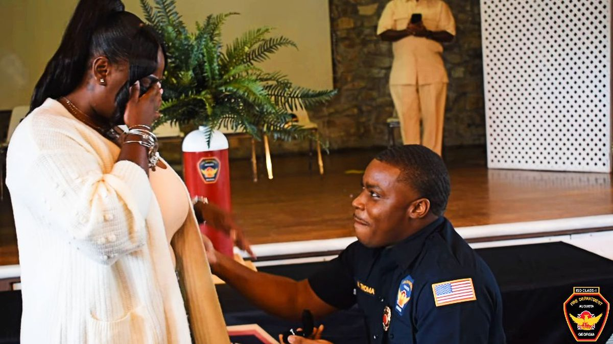 Firefighter Marcus Thomas proposed to Olive Golatt during his pinning ceremony.