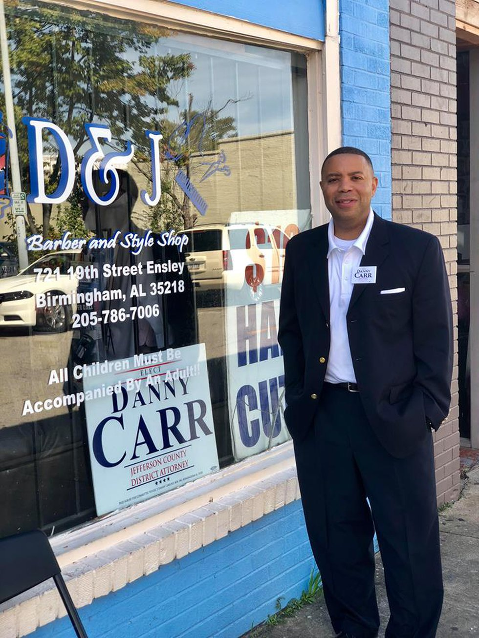 Danny Carr outside D & J Barber Shop in Ensley, named for him and his brother, who was killed.