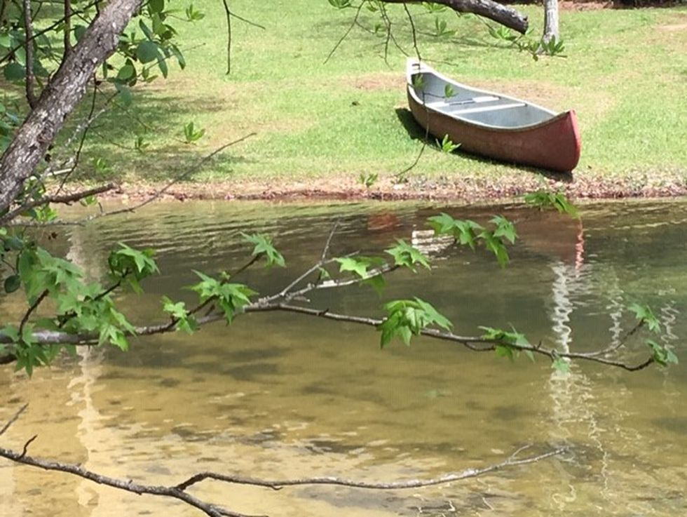 The canoe rests on the shore of Lake Martin in Parker Creek, 10 miles southwest of Alex City.