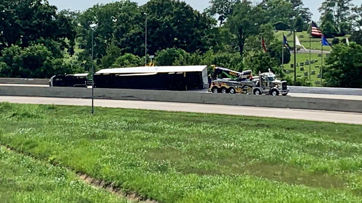 An 18-wheeler overturned at Dead Man's Curve Friday afternoon.