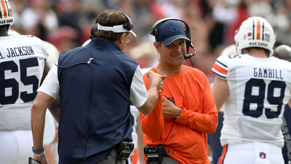 Gus Malzahn and Kevin Steele first bump celebrate together after a score in the second...