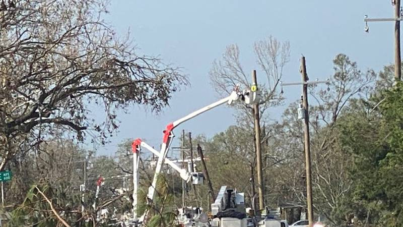 Britt Clayton and a team of about 50 Alabama linemen are working on restoring power to...
