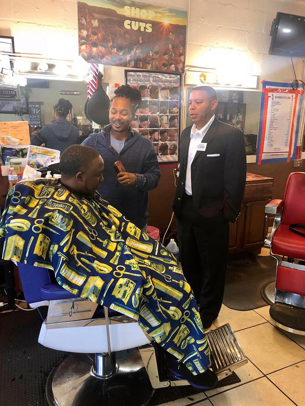 Danny Carr inside the barber shop he owns in Ensley.