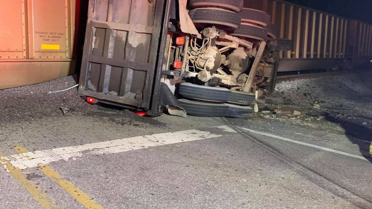 A dump truck was hit by a train in Alabaster Wednesday night.