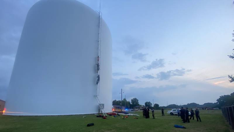 Officers rescue woman from a water tower