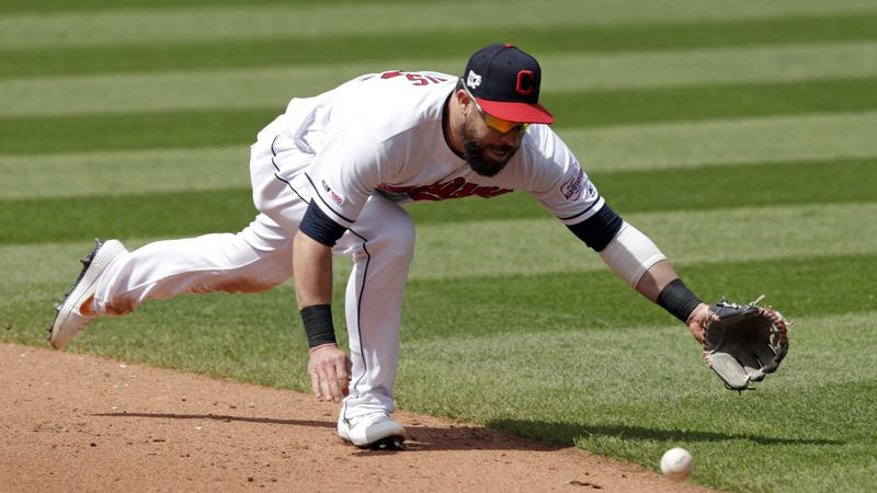 Cleveland Indians' Jason Kipnis tries to field a ball hit by Miami Marlins' Miguel Rojas in the...