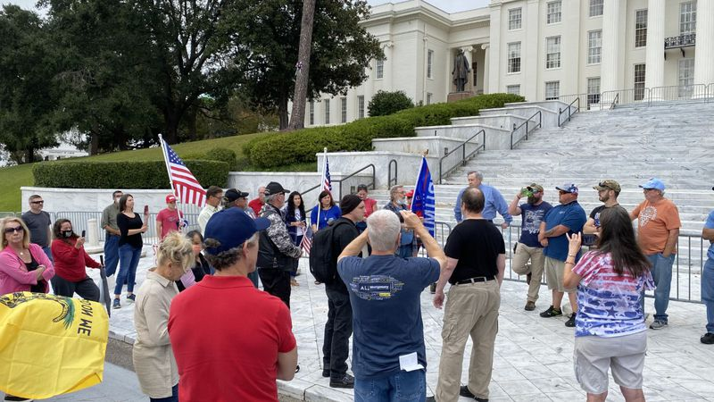 In Montgomery, a few protesters rallied on the steps of the state capital opposing the results...