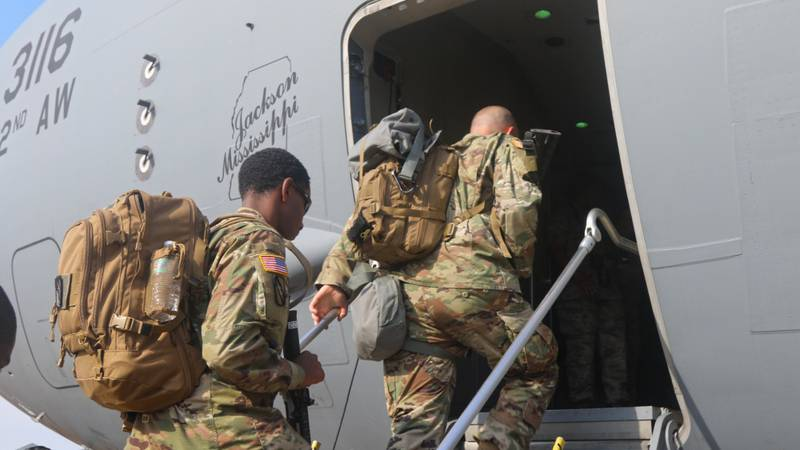 Soldiers with the 155th Armored Brigade Combat Team, Mississippi Army National Guard, board a...