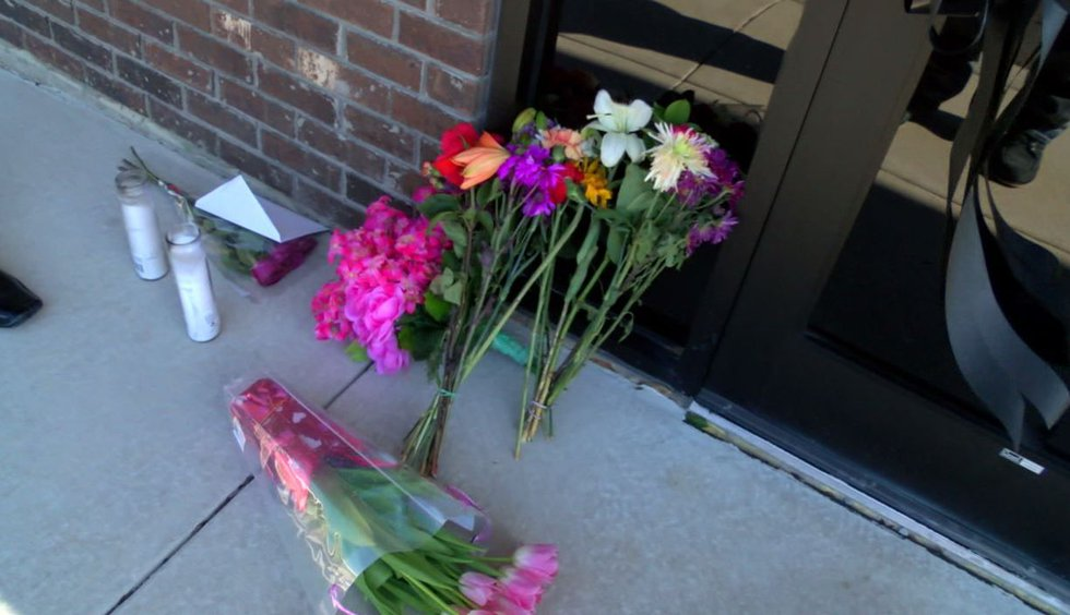 Flowers are left outside Linda Cole's office in Hamilton. Source: WBRC video