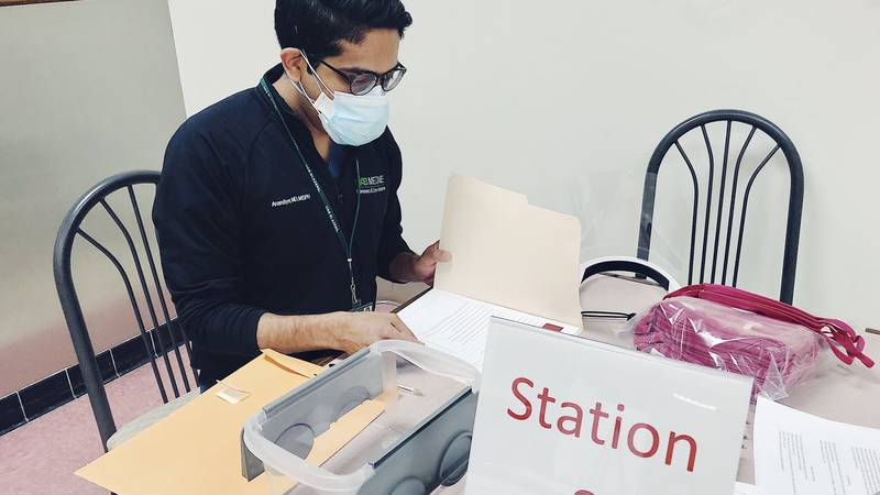 Dr. Ananyd Iyer checks in patients receiving the COVID-19 vaccine at Cooper Green Mercy Health...