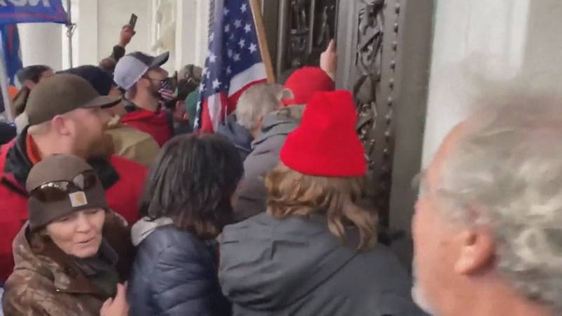 A crowd forces entry into the U.S. Capitol on January 6.