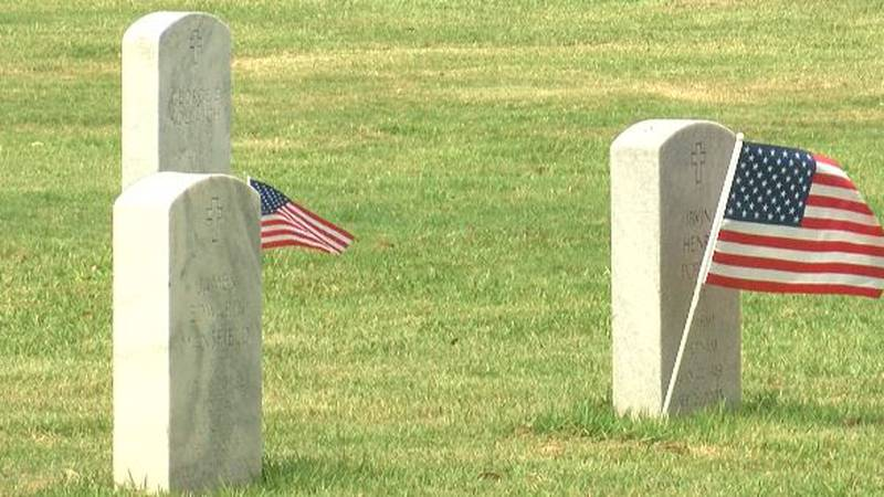 Even though flags were not scattered across the hallowed grounds, friends and family members of...