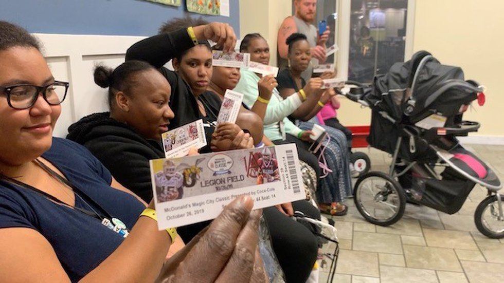 Families receive their tickets.