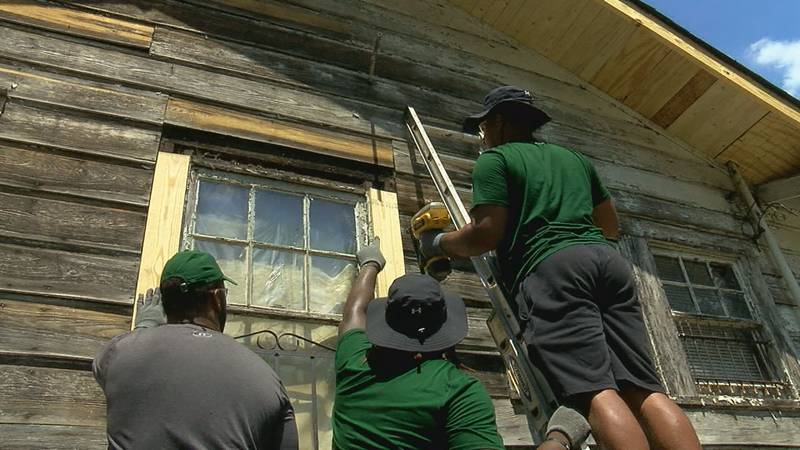 UAB football players help rebuild a home off 14th Avenue North with Habitat for Humanity.