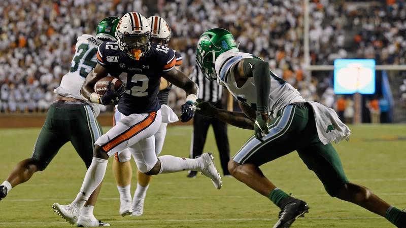 Eli Stove scores Auburn's 2nd touchdown.Auburn Football Tulane at Auburn on Saturday, Sept. 7,...