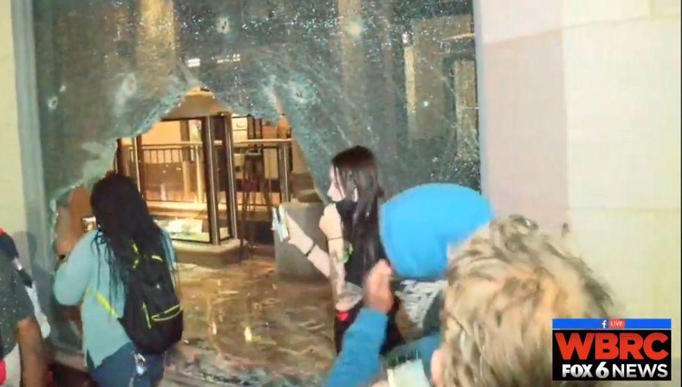 Protesters smash windows, break into Alabama Power museum