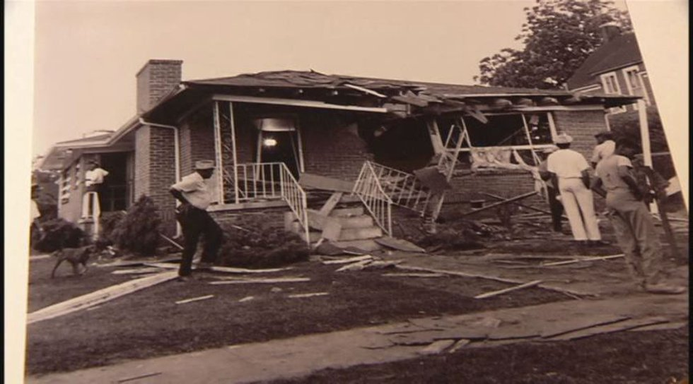McNair took this photograph of a residential bombing, one of dozens that happened in the 60's....