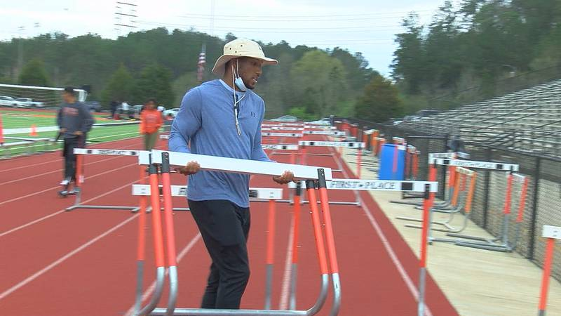 The former Alabama and Hoover High School football star is a track coach during his offseason.