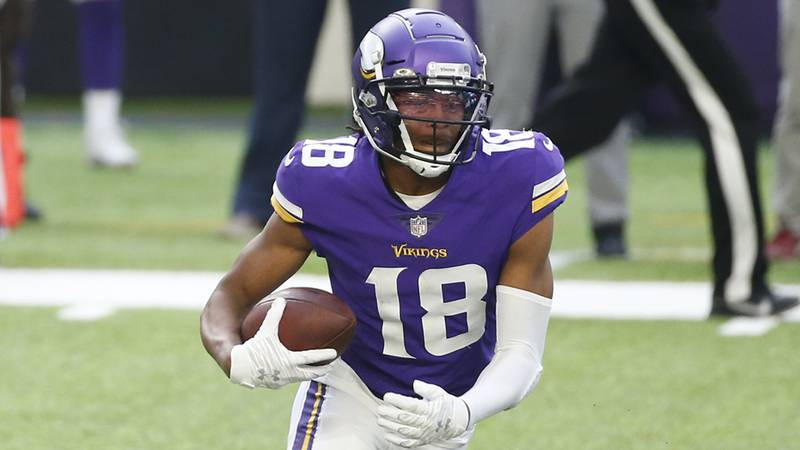 Minnesota Vikings wide receiver Justin Jefferson runs up field during the second half of an NFL...