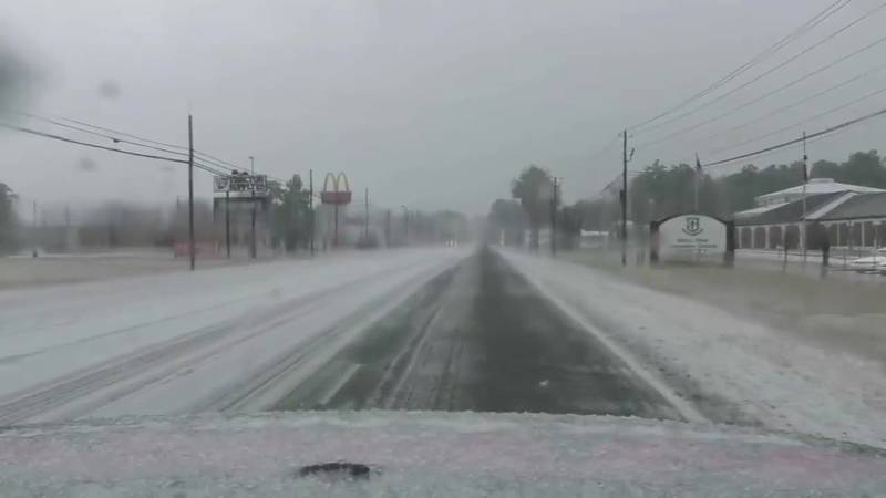 Jeh Jeh Pruitt checks out road conditions in Marion County