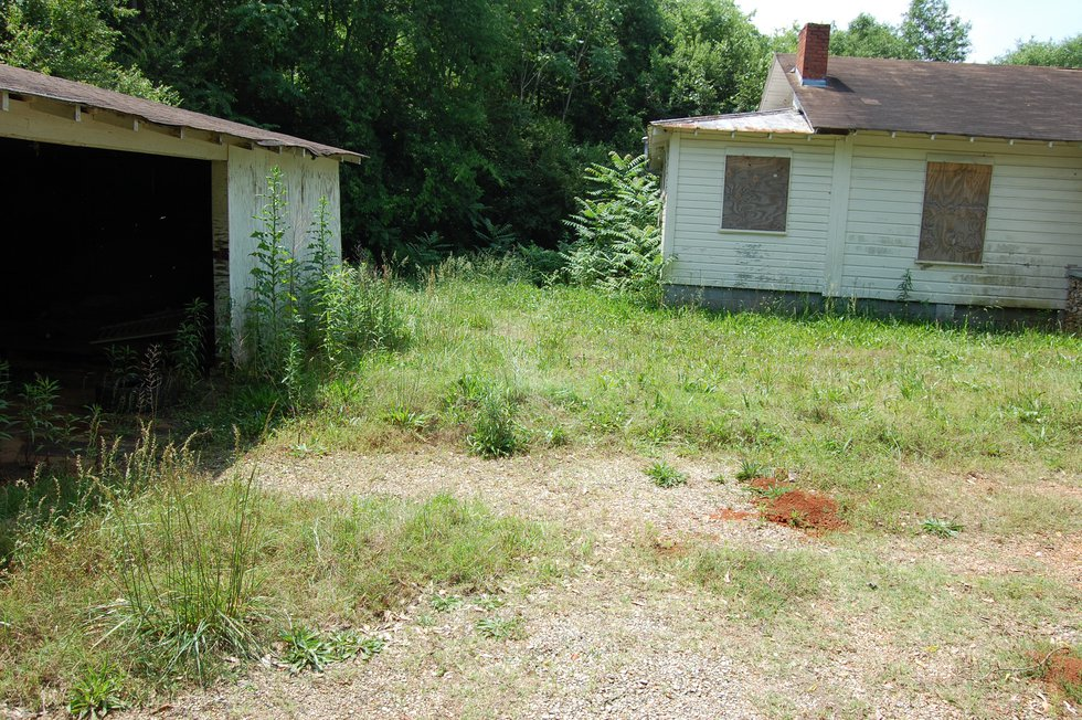 The remains of an unidentified woman were found in this backyard in May 2012.
