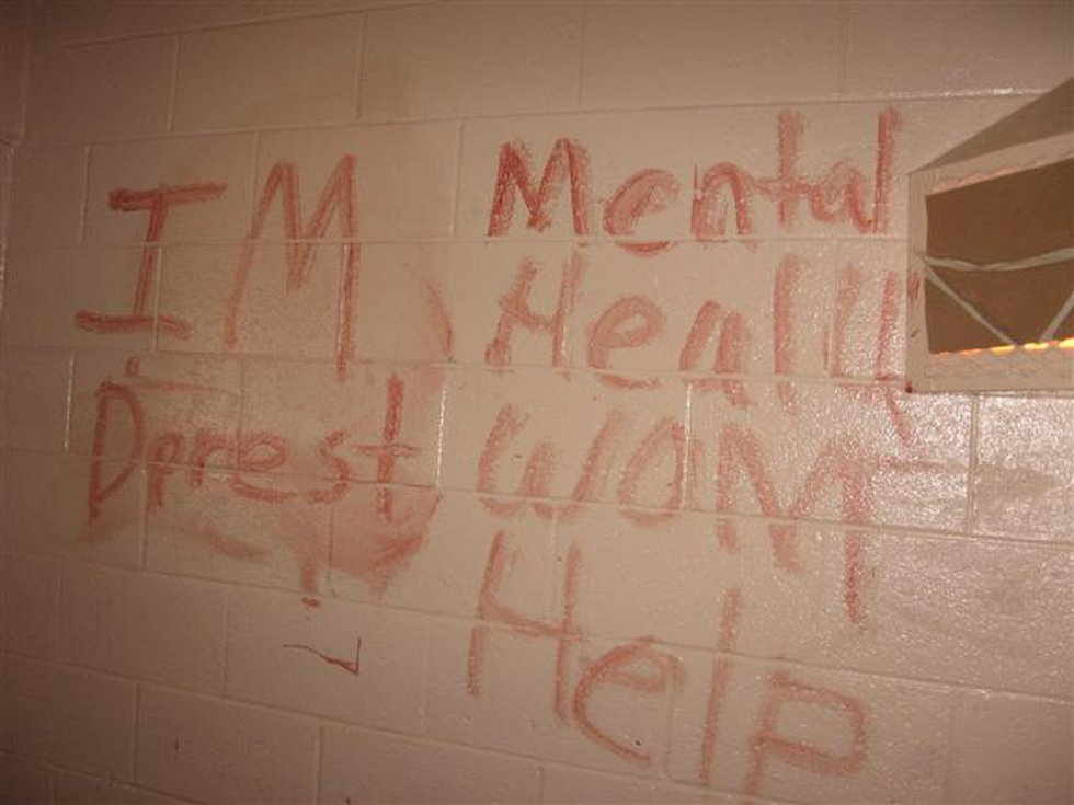 Writing in blood by prisoner with a mental illness. (Photo sent to WBRC)