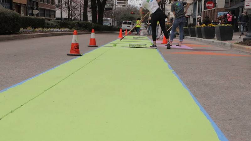 Striping and painting started Wednesday on drawing so-called flex lanes on 20th street between...