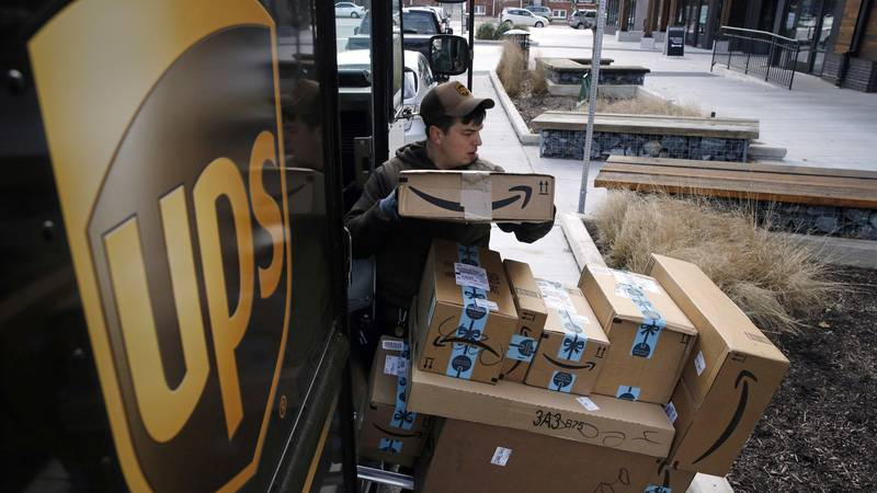 FILE- In this Dec. 19, 2018, file photo a UPS driver prepares to deliver packages. (AP...