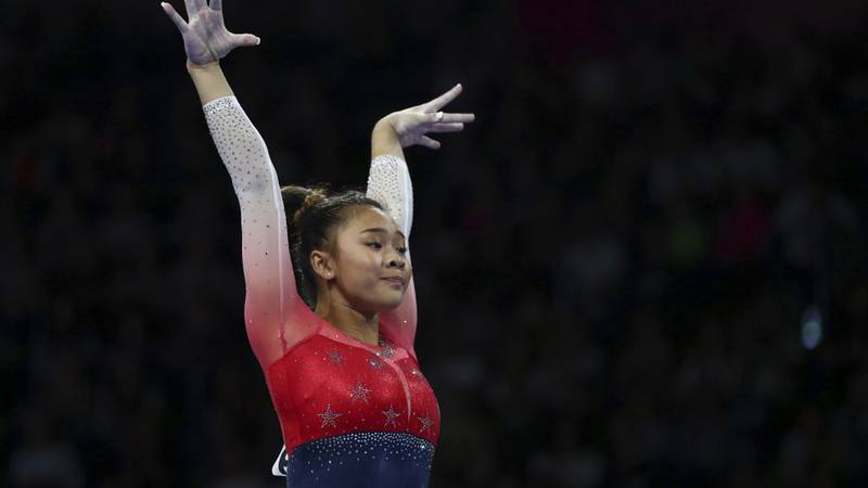 Sunisa Lee of the U.S. performs on the balance beam during women's team final at the Gymnastics...