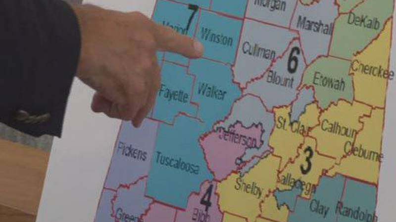 A representative points to a map of Alabama during the redistricting hearings that were held on...