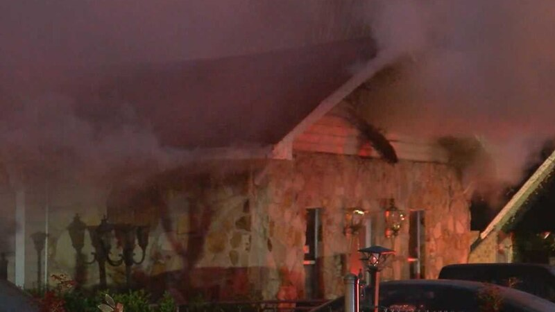 Birmingham firefighters are investigating a house fire on Alemeda Avenue. (Source: WBRC Video)
