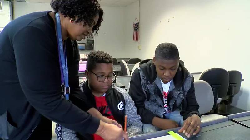 Barbara Dunham works with some of her career tech students at Bessemer City Middle School