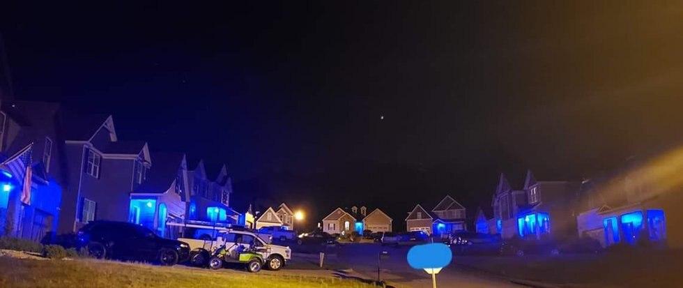 A photo shows multiple houses in fallen Auburn police officer William Buechner's neighborhood...
