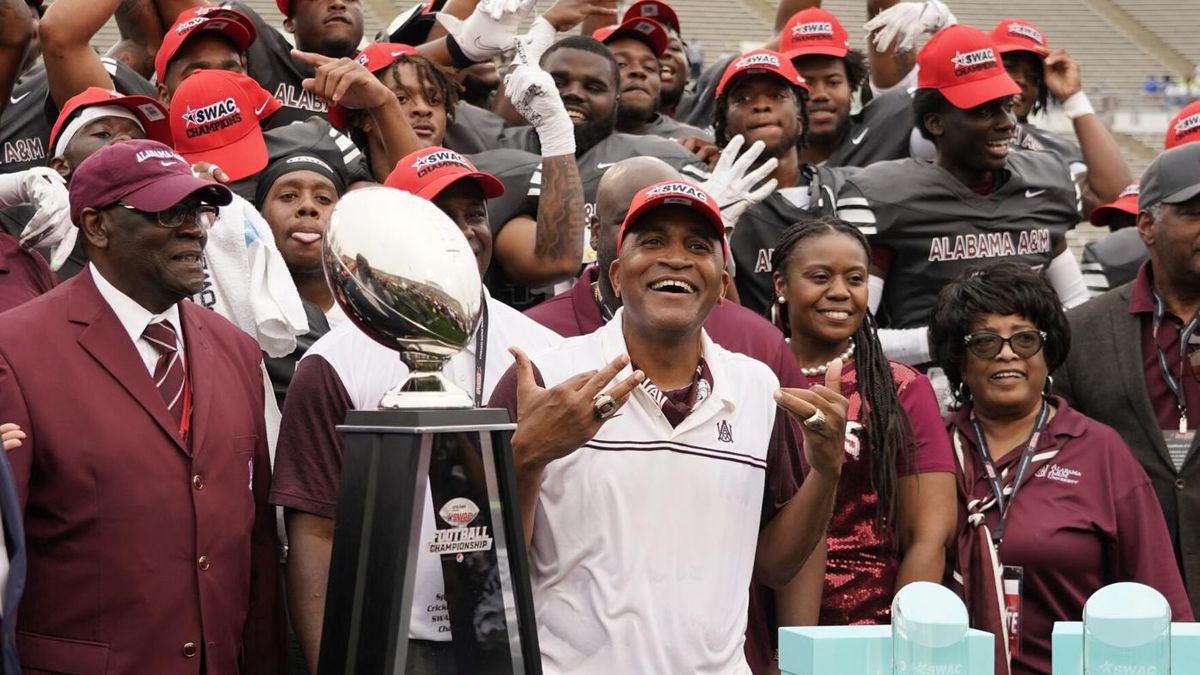 Alabama A&M Head Coach Connell Maynor celebrates a 40-33 win over Arkansas Pine-Bluff in The...